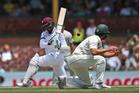 West Indies batsman Denesh Ramdin, left, plays a shot during their test match against Australia in Sydney. Photo / AP
