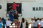 David Hernandez, top, and Marta Miguel arrive at Kota Kinabaluport. Photo / AP