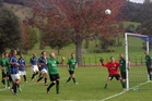 THE FALLING LEAF: Kaeo Inter attack the Madhatters Black goal from a corner in a feisty affair from the Northland 2nd Division in Kaeo on Saturday which finished 3-all.