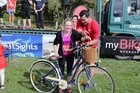 Jasmine Kitchen won a brand new bike, presented by Jennian Homes Northland owner Brett Yakas.