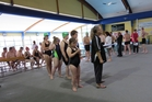Competitors line up to take to the pool.