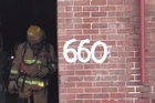 Three people have been taken to hospital after a blaze at the Dunedin flat where the band Six60 formed.