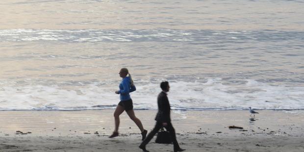 Many can still find solitude on Takapuna Beach.