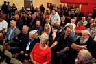 A packed meeting with irate Otaika Valley residents. Photo / John Stone