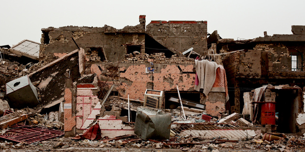A family house lies in ruins in the Iraqi city of Ramadi in March, weeks after the city was retaken from Isis. Iraq remains a politically unstable and violence-prone land. Photo / AP