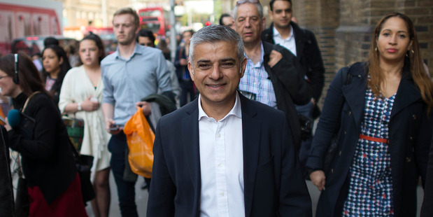 """Newly elected London's Mayor Sadiq Khan, centre, called dirty air """"our most pressing environmental challenge"""". Photo / AP"""