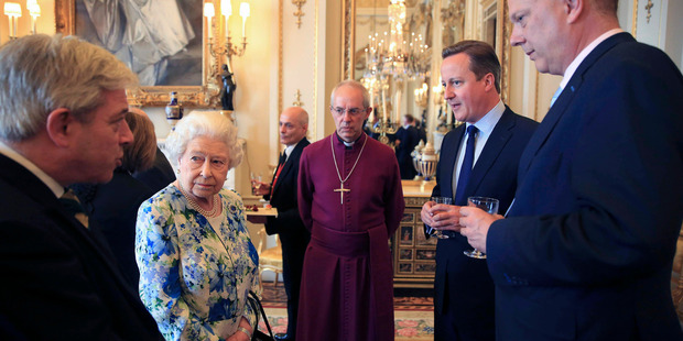The Queen speaks to Prime Minister David Cameron, second right, as leader of the House of Commons Chris Grayling, right, and Archbishop of Canterbury Justin Welby, look on. Photo / AP