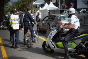 Police officers patrol in front of the entrance of the Festival Palace in Cannes southern France. Photo / AP