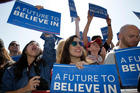 Supporters of Democratic presidential candidate, Senator Bernie Sanders, cheer for their candidate in Stockton, California. Photo / AP