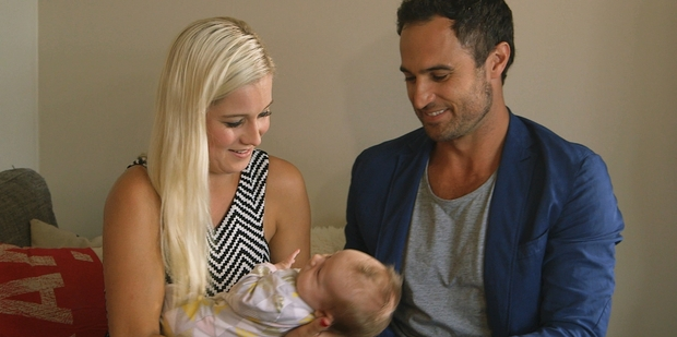 Jordan with a baby (not his) and Fleur Verhoeven, one of the finalists on The Bachelor NZ. Photo/TV3
