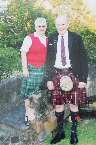 Dannevirke's Glennis McDonald (left) and her husband Ian, chief of the Southern Hawke's Bay Scottish Society for the past 43 years, wearing his clan Ranald tartan.