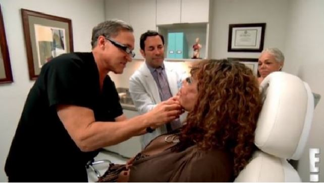 Dr Terry Dubrow and Dr Paul Nassif with Narinesingh on the set of Botched. Photo / E!