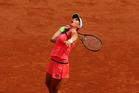 Marina Erakovic serves against Petra Kvitova at the 2015 French Open. Photo / Getty Images