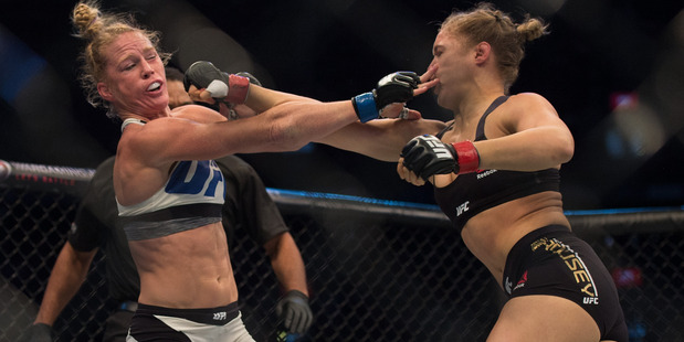 Ronda Rousey (right) fights Holly Holm fight each other in their UFC bantamweight championship belt at UFC 193 in November last year. Photo / Getty Images