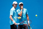 Marcus Daniell and Artem Sitak talk tactics during the Australian Open. Photo / Getty Images
