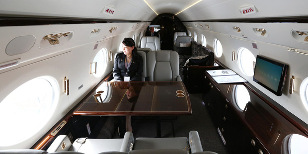 An employee sits inside a Gulfstream G450 business jet. These planes cost US$57 million. Photo / Getty