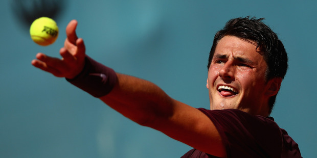 Bernard Tomic serves against Fabio Fognini of Italy. Photo / Getty Images