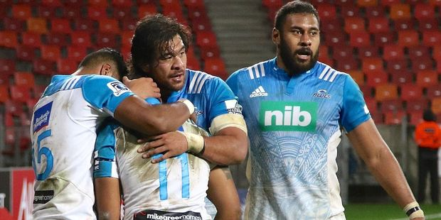 Teammates congratulate Tevita Li of Blues for his bonus point try against the Kings. Photo / Getty