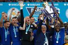 Leicester City's manager Claudio Ranieri and captain Wes Morgan hold up the Premier league trophy. Photo / Getty