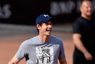 Andy Murray laughs during a training session. Photo / Getty Images
