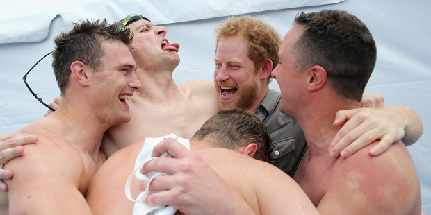 Prince Harry celebrates with UK Armed Forces Team won gold at the swimming pool during the Invictus Games. Photo / Getty Images