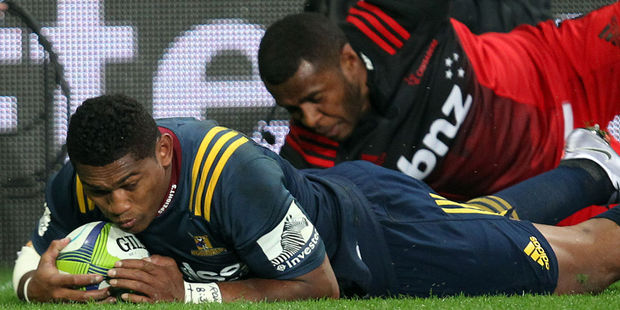 Waisake Naholo of the Highlanders scores a try against the Crusaders. Photo / Getty