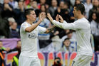 Real Madrid's James Rodriguez celebrates after scoring with his teammate Cristiano Ronaldo. Photo / Getty