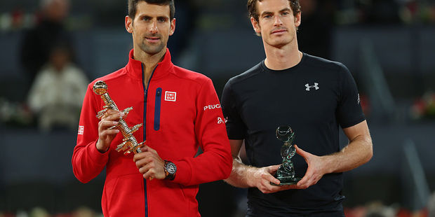 Novak Djokovic and Andy Murray hold their trophies after the mens final of the Madrid Open. Photo / Getty