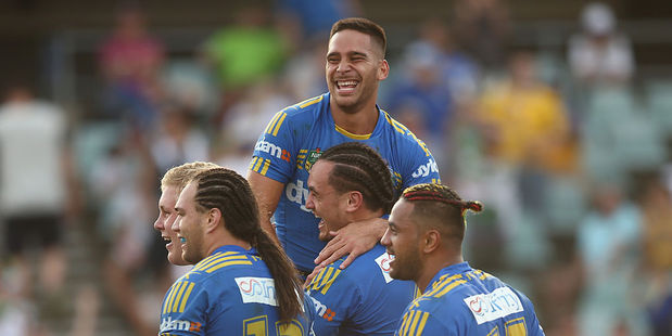 Corey Norman (top) celebrates a try with his Parramatta Eels team mates. Photo / Getty