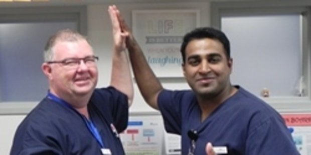 Clinical Coordinator and Registered Nurse Jake Reid (left) Hi-5s Registered Nurse Nitin Scaria (right) in recognition of International Nurses Day. Photo/supplied
