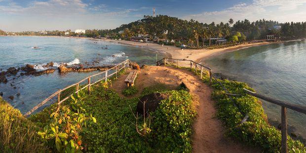 A beach in the town of Mirissa, Sri Lanka. Photo / 123RF