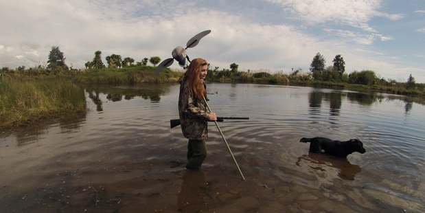 Georgia Williamson at a wetland near Te Puke. Game bird hunters use decoys to try to lure ducks. PHOTO/FISH&GAME