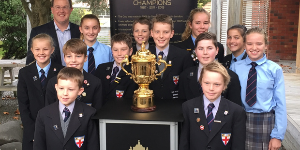 PROUD MOMENT: Dr Ian Murphy and some of the St George students with the William Webb Ellis trophy.