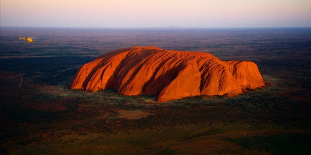 Climbing Uluru is perfectly legal and thousands of tourists scale the rock each year. Photo / 123RF