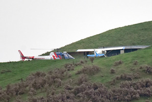 The Rotorua-based BayTrust Rescue Helicopter landed next to a second plane which was flying with the crashed aircraft. Photo/George Novak