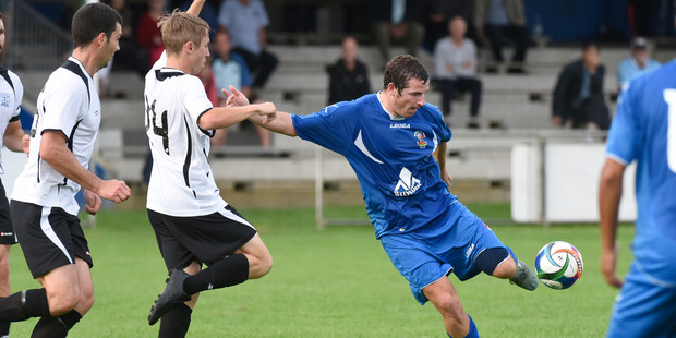 Colm Kenny scored both of Tauranga City United's goals as they came back from 2-0 down to draw with East Coast Bays. Photo / George Novak