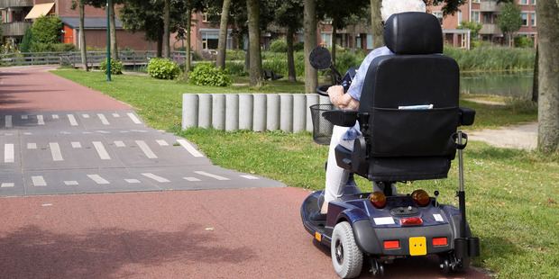 An elderly woman was killed when she was knocked off her mobility scooter by a reversing car. Photo / Getty