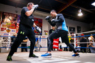 Joseph Parker (right) spars in the ring with trainer Kevin Barry in East Tamaki yesterday. Photo / Dean Purcell