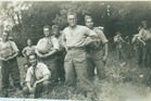 Hekia Parata's grandfather Arnold Reedy (centre of image with hands on hips) in England during WWII. Photo / Supplied