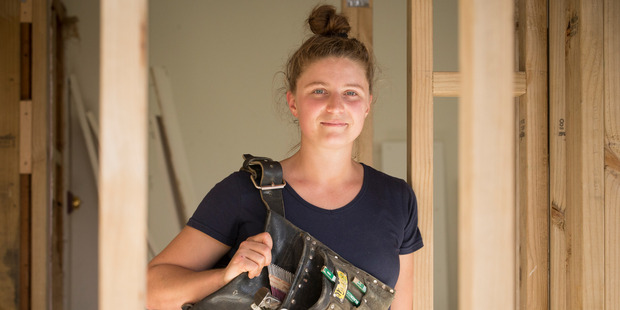 """Loading Qualified carpenter Kate Ross, 28, said that aside from a couple of """"old school blokes"""" she's never had a problem being a woman onsite. Photo / Greg Bowker"""