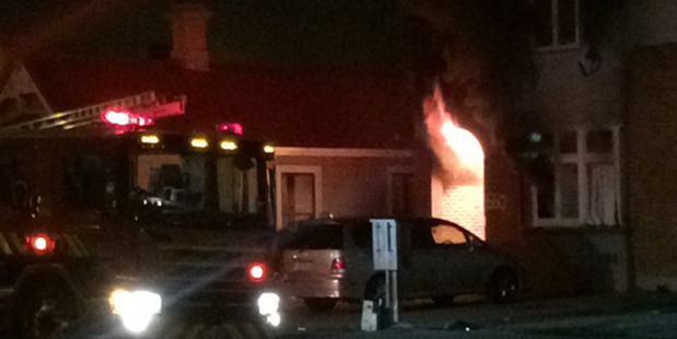 Fire officers attend the scene of a fire at 660 Castle St Dunedin. Photo / Supplied