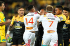 Referee Craig Joubert watches on as Chiefs' Toni Pulu & Sam Cane are involved in a bust up with Hurricanes' Julian Savea during the Round 9 Super Rugby match. Photo / Getty Images