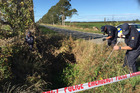 Police scour the area on Drain Rd near where the body of Marcus Luke Tucker was found at Lake Ellesmere. Photo / Kurt Bayer