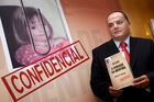 Former detective Goncalo Amaral poses with his book The Truth in the Lies during its launch in Lisbon in 2008. Photo / AP