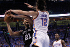 Steven Adams defends Tim Duncan during the Thunder's clinching victory over the Spurs. Photo / AP
