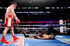 Canelo Alvarez watches after knocking out Amir Khan during their WBC middleweight title fight. Photo / AP