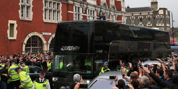 Riot police were on hand when the Manchester United team arrived at Upton Park. Photo / AP