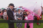 The Queen talks to Commander Lucy D'Orsi at a garden party held at Buckingham Palace. Photo / AP