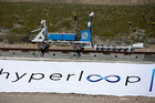 A recovery vehicle moves a sled down a track after a test of a Hyperloop One propulsion system. Photo / AP