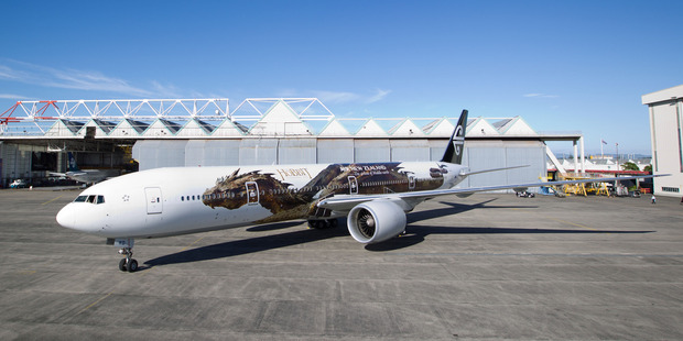 Air New Zealand's Boeing 777-300, decorated with the 54m dragon Smaug, from Peter Jackson's film The Hobbit: The Desolation of Smaug. Photo / Richard Robinson